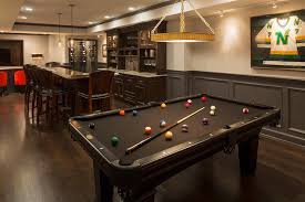 Pictures Of Finished Basements With Bars by Basement Boasts A Built In Wet Bar Next To A Black Pool Table