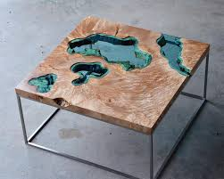 new wood tables and wall embedded with glass rivers and lakes