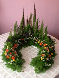 Funeral Flower Designs - miniature forest themed arrangement meant for and urn tribute by