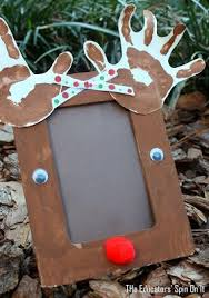 Kids Reindeer Crafts - adorable handprint reindeer craft frame for the holidays spin