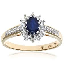 diamond set naava sapphire and 12 diamond set shoulders 9 ct yellow gold ring
