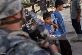 us troops patrol restive areas of baghdad photos and images