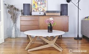 amazing this coffee table convert to a dining in one move at
