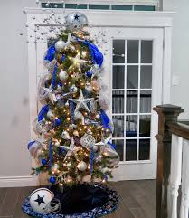 themed christmas tree by the pool it s just better dallas cowboys themed
