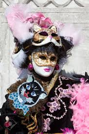 venetian costumes black costume with cat masks at the venice carnival stock photo