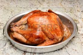 a roasted thanksgiving turkey with all the trimmings on a light