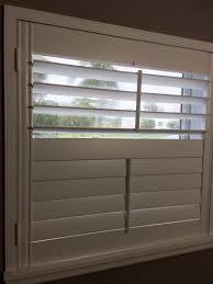 custom wood plantation shutters with split tilt bar standard trim