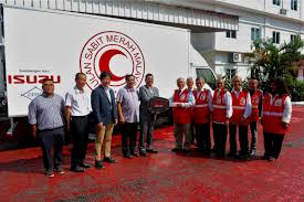 volvo n series trucks isuzu malaysia donates truck to red crescent society autoworld