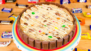 giant cookie cake with leftover halloween candy from cookies