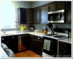 how to paint oak cabinets black oak cabinets painted to this chocolate color oak