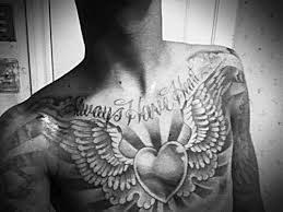 grey ink wings tattoos on chest in 2017 photo