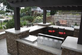 kitchen design l shape stone outdoor kitchen on concrete floor covered outdoor kitchen with black pergola and brick cabinet near swimming pool full size