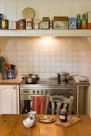 Decorating Above Cabinets In Kitchen Pictures How To Decorate Above Your Kitchen Cabinets In 3 Easy Steps Home