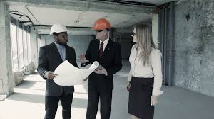 man woman african american in suit and hard hat consider
