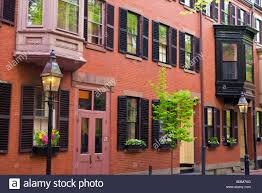 brick houses and gas street lamps on beacon hill boston stock