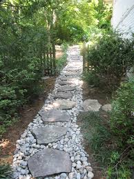 dry creek with boulder steppers side yard drainage solution