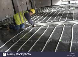 installing underfloor heating waste heat recovered from