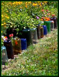upcycle glass bottles into a garden border natural green mom