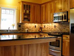 rustic hickory cabinets kitchen farmhouse with red dishes