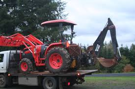 backhoe taking a chance on a used backhoe attachment