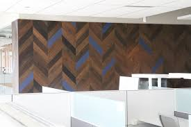 unique chevron pattern plank wall with blue accents requested by