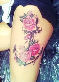 rose flowers and anchor tattoo on thigh