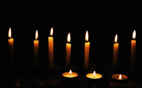 each small candle lights a corner of the