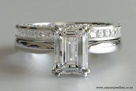 solitaire emerald cut engagement rings emerald cut solitaire engagement ring with princess cut