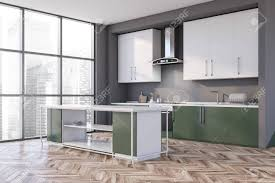 white kitchen cabinets with green countertops corner of modern kitchen with gray walls wooden floor green