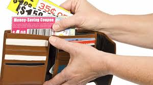 how to extreme coupon save on groceries extreme couponing 101 taking coupon out of wallet