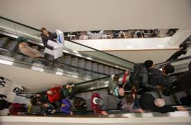 shoppers hit the stores on thanksgiving as black friday hours vary