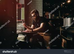 royalty free a bearded male is checking e mail on a u2026 512616112