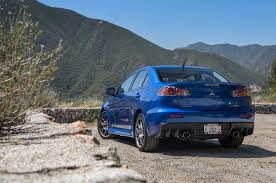 blue mitsubishi lancer q u0026a mitsubishi on the soon to be late great lancer evolution