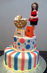 2 tier baby shower cake with pregnant woman shopping bags