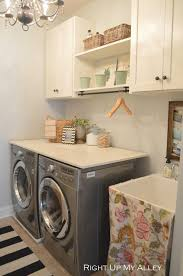 Laundry Room Storage Between Washer And Dryer by Beautifully Organized Small Laundry Rooms The Happy Housie