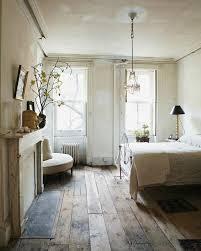 rustic guest bedroom with hardwood floors crown molding zillow