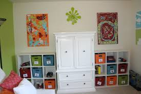 ravishing kids playroom ideas with white finish wooden cupboard