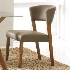 grey leather upholstered dining chairs without arms on shaggy area