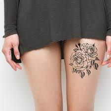 black and white flower thigh tattoos marcia richards