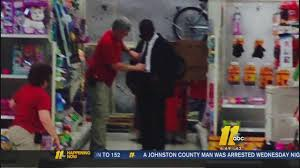 target employees black friday target employees help young man prep for job interview tie his