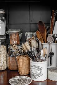 kitchen jars and canisters love the flip top jars and white ceramic utensil jars jars and