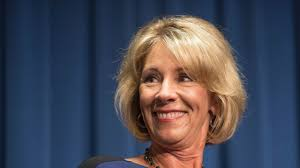 betsy devos outsmarted protesters by cleverly using other door