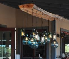 chandelier live moonshine lamp chandeliers this beautiful wood and glass custom