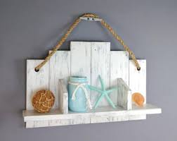 White Bathroom Shelf With Hooks by Distressed White Bathroom Shelving Over The Toiletchunky