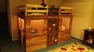 Crib Loft Bed Bunk Bed Playhouse Using Crib Mattresses And A Climbing Wall