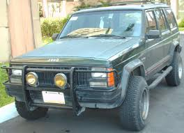 jeep cherokee green file 1984 1996 jeep cherokee xj 4 door jpg wikimedia commons