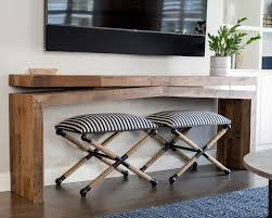 console table under tv black and white stools with base transitional living room