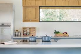 sustainable kitchens charlie luxton collaborations sustainable island breakfast bar in a flat panel oak kitchen with polished concrete worktops