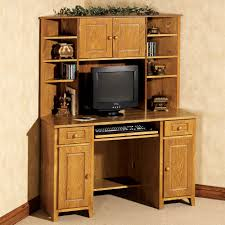 light brown stained oak wood corner desk with hutch and display