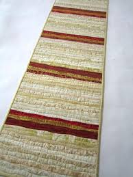 gold christmas table runner christmas table runner in cream red and gold patchwork mountain